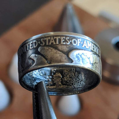 A customer's Walking Liberty turned into a coin ring with the 'eagle out'.