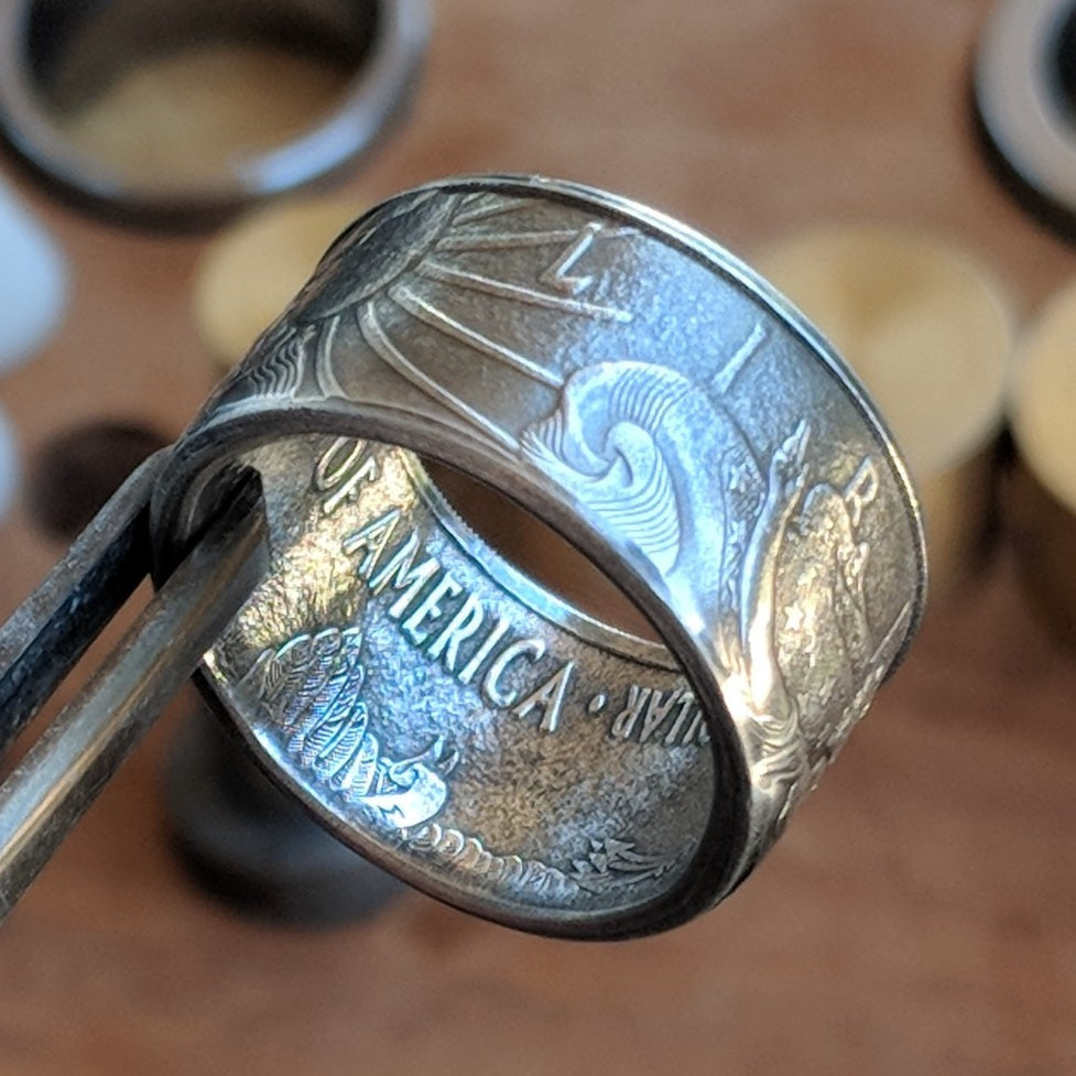 Silver Eagle coin ring with the Rising Sun and 'Liberty' displayed on the outside.