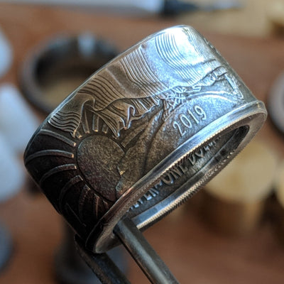 Silver Eagle coin ring with the year showing on the outside of the band.