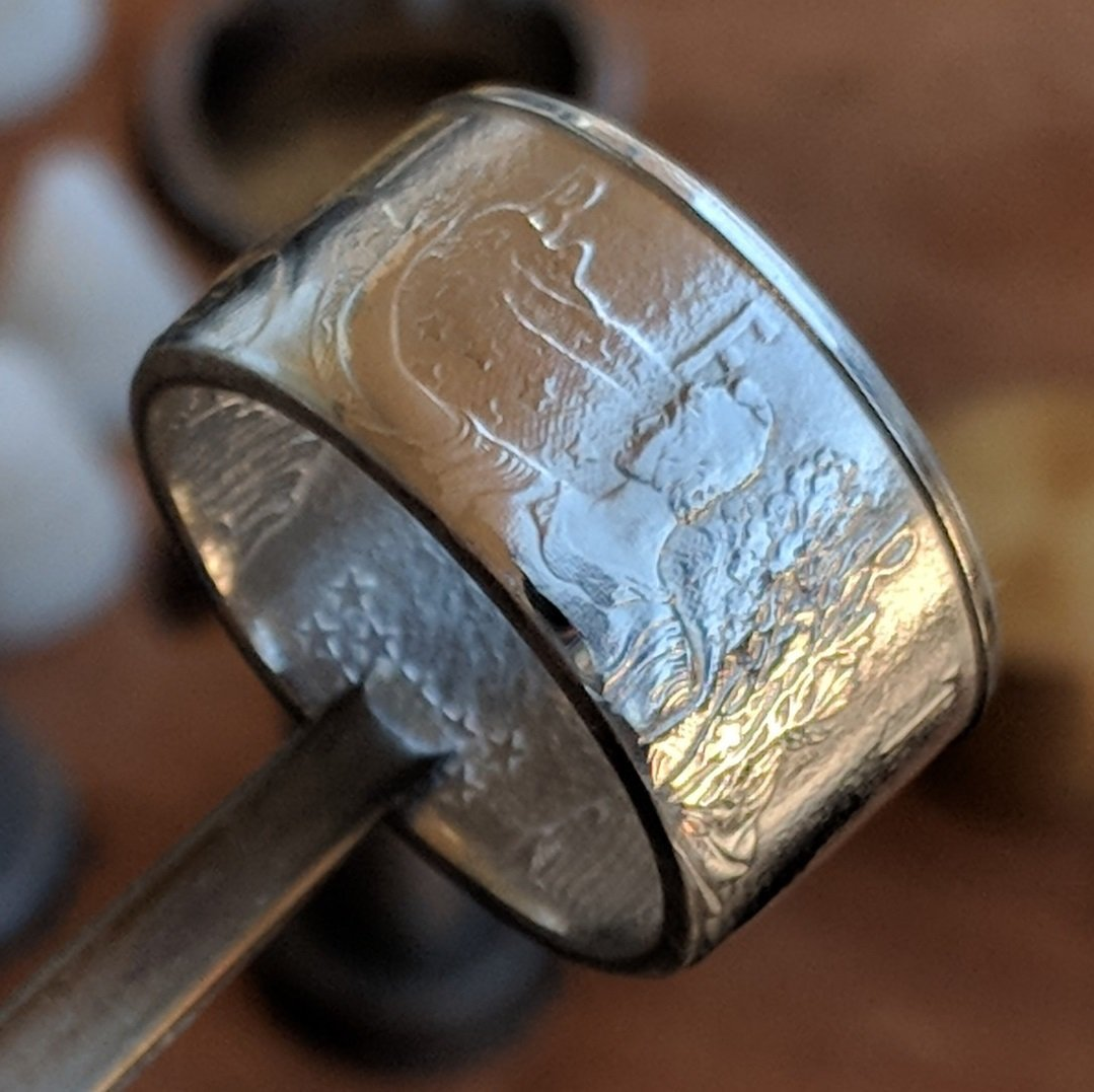 Polished American Silver Eagle coin ring made from a customer's coin