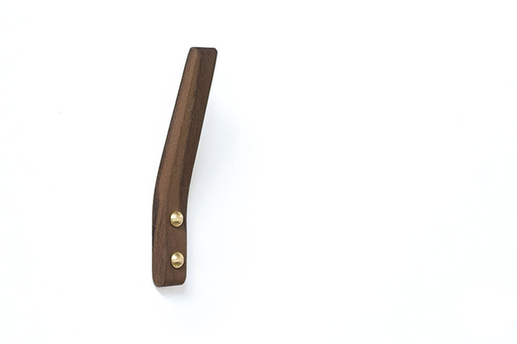 A modern wood coat hook in oak