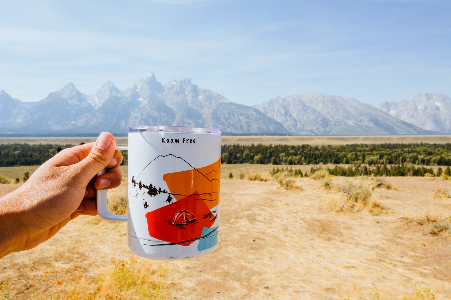 Hand-printed in Arizona camp mug with Grand Teton National Park views in the background