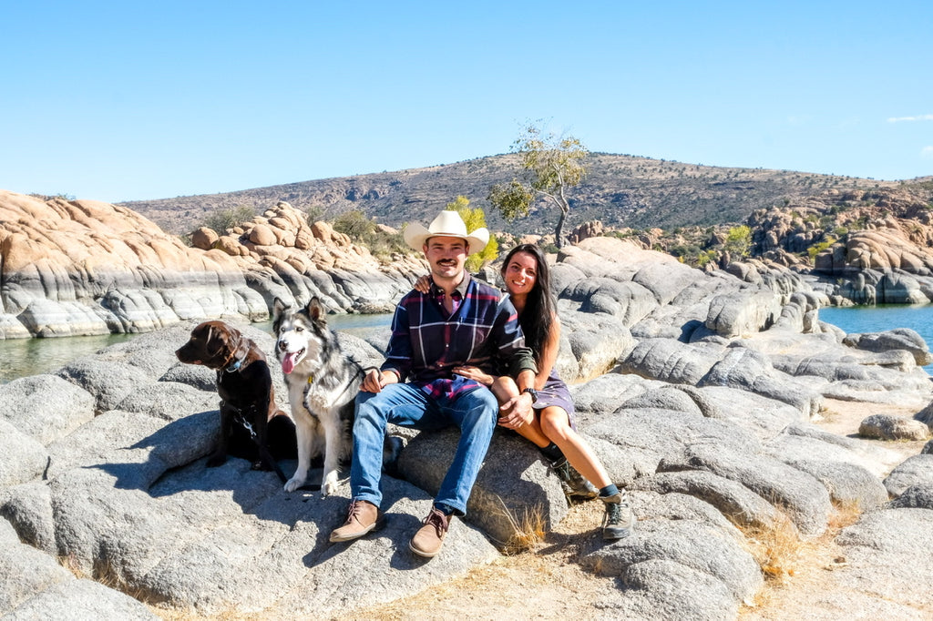 Arizona family camping between the boulders with dogs huskie and a lab