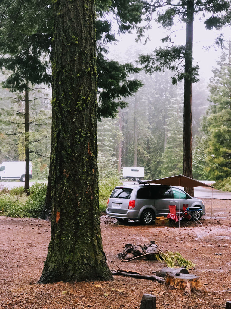 campervan camping in the forest near Yosemite - snow