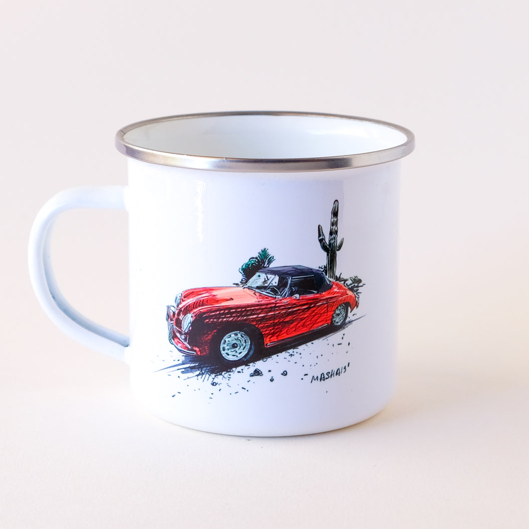 Red Prorsche convertible next to a saguaro cactus camp mug