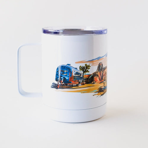 Tumble mug hand-printed in Arizona that features airstream in Joshua tree national park desert scenery and an epic sunset