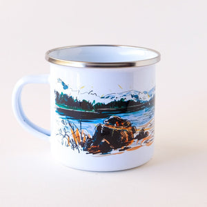 enamel camp mug that showcases that Pacific Northwest weekend by the lake with pit fire and a canoe