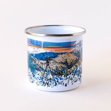 Load image into Gallery viewer, Enamel camp mug hand-printed in Arizona that features desert landscapes and an epic sunset with a deer buck hiding in the brush