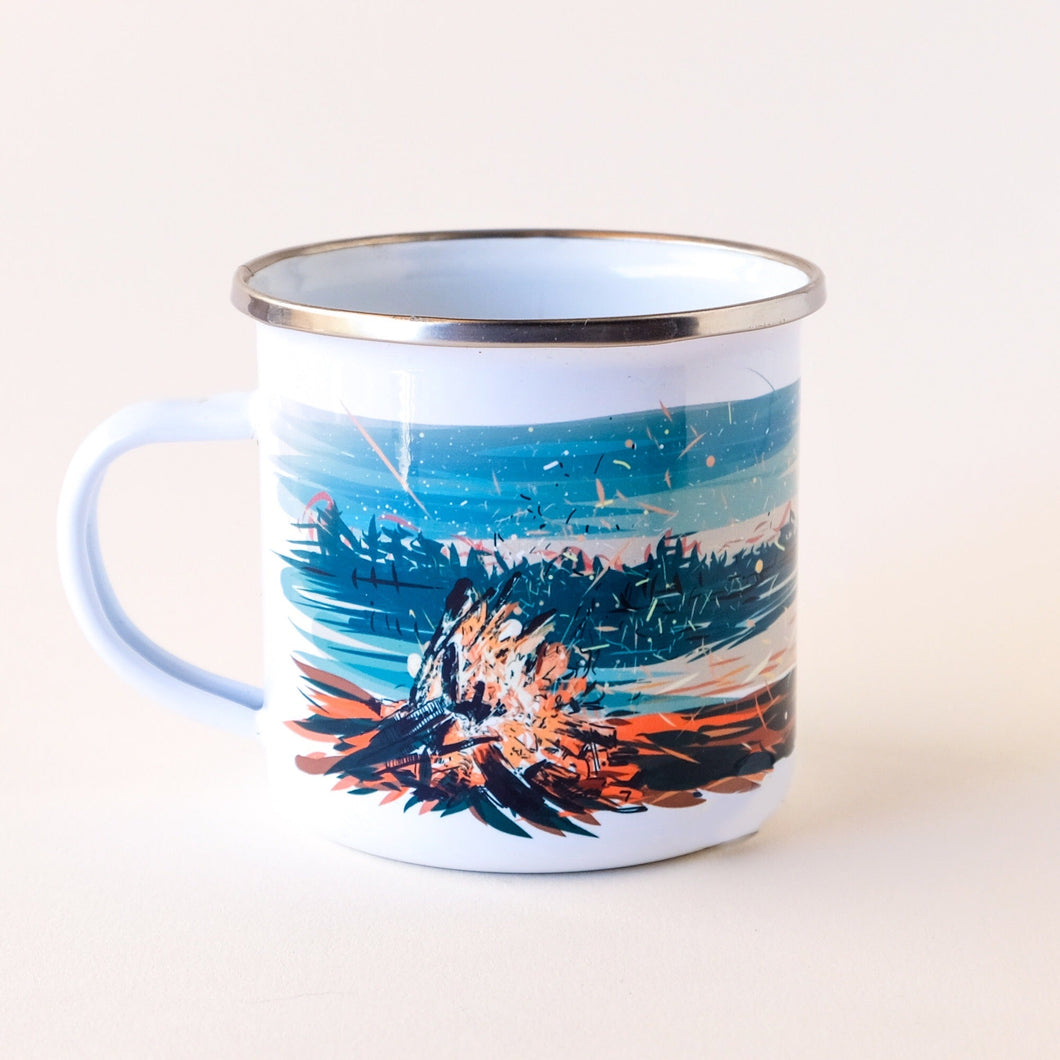 enamel camp mug hand-printed in Arizona that features the sunset by the lake with a large campfire that its the sky with sparkles