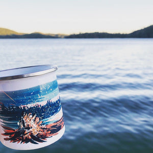 Enamel camp coffee mug made from a highest grade stainless steel with original artwork of the summer by the lake and a campfire at lake Chasta