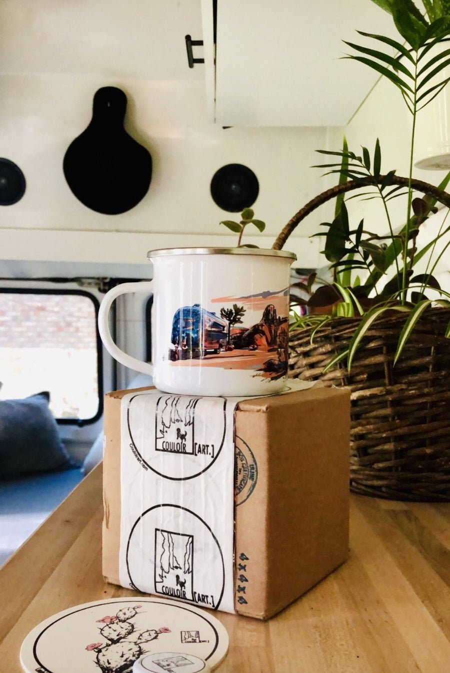 Joshua tree camp mug in the campervan setting