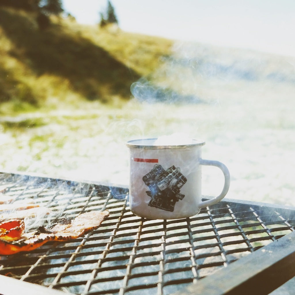 made in Arizona enamel camp mug with stainless steel rim that features waffles and bacon cooked straight over the open fire
