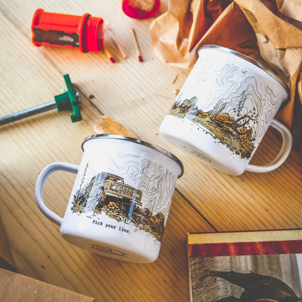 Father's Day limited edition camp mug hand-printed in Arizona that depics a classic Ford Bronco climbing up the off-road trail in desert mountains