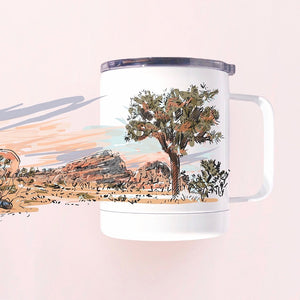Insulated tumbler mug hand-printed in Arizona that features airstream in Joshua tree national park desert scenery and an epic sunset