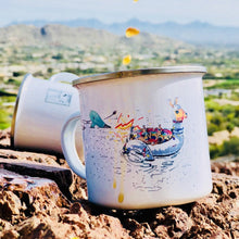 Load image into Gallery viewer, enamel camp mug that features comic summer vibes and a hairdryer attacking the sunbathing company on the lama floatie