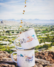 Load image into Gallery viewer, enamel camp mug han-printed in Arizona that features a road bike on the hot strada design and a hairdrier