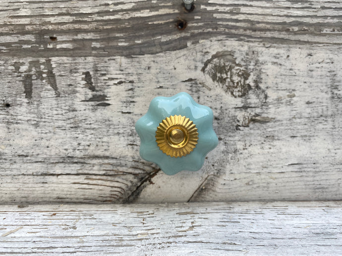 Teal and gold flower shaped knobs