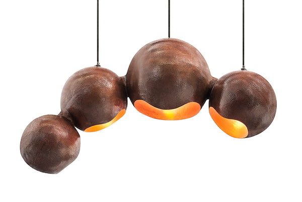 Modern sculptural hand made copper pendant lamp with a contemporary brown patina finish