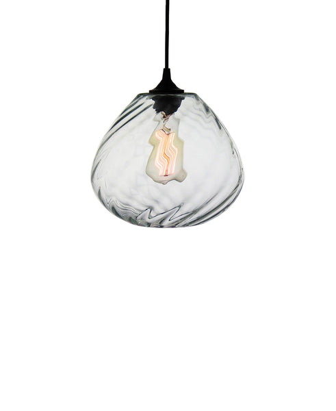 Patterned contemporary hand blown glass pendant lamp in seductive transparent glass