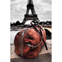Load image into Gallery viewer, Floto Parma Italian Leather Duffle Travel Bag Carryon Suitcase Luggage - Lifestyle Image (Paris)
