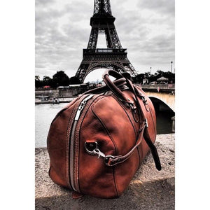 Floto Parma Italian Leather Duffle Travel Bag Carryon Suitcase Luggage - Lifestyle Image (Paris)