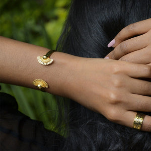 A Model's Hand wearing Yenaé 14K Gold Plated Tsirur Bracelet
