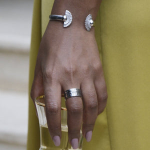A Model's Hand Wearing Yenaé Rhodium Plated Tsirur Bracelet
