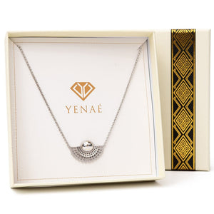 Yenaé Rhodium plated Tsirur Necklace in a box.