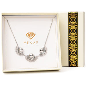 Yenaé Rhodium Tsirur Statement Necklace displayed in a box.