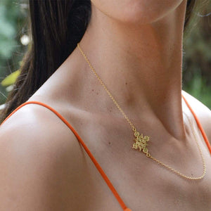 A Model Wearing Yenaé 14K Gold Plated Lalibela Side Cross Pendant Necklace