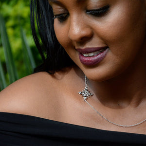 A Model Wearing Yenaé Rhodium Plated Lalibela Side Cross Pendant Necklace