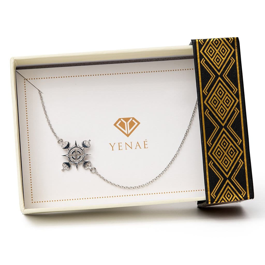 Yenaé Rhodium Plated Lalibela Side Cross Pendant Necklace displayed in a gift box