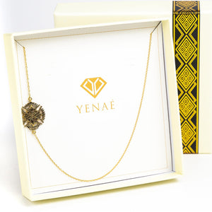 Yenaé Jewelry Collection 14 carat gold plated Axum Antique Ethiopian cross displayed in a box..