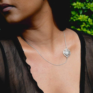 A Model Wearing Yenaé Rhodium Plated Axum Side Cross Pendant Necklace
