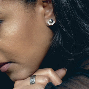 A Model Wearing Yenaé Rhodium Plated Tsirur Ear Studs