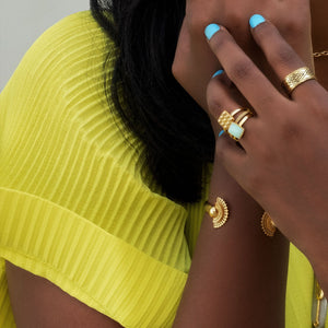 Yenaé Jewelry Collection 14 carat gold plated semi-precious chrysoprase gemstone Teslom Stackable Ring worn by a model.