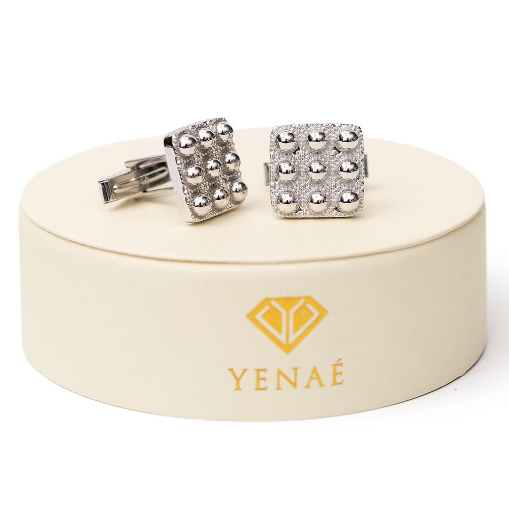 Yenaé RhodiumPlated Telsom Dome cufflink displayed on package.