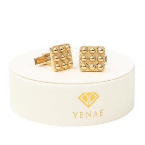 Yenaé 14K Gold Plated Telsom Dome cufflink displayed on package.