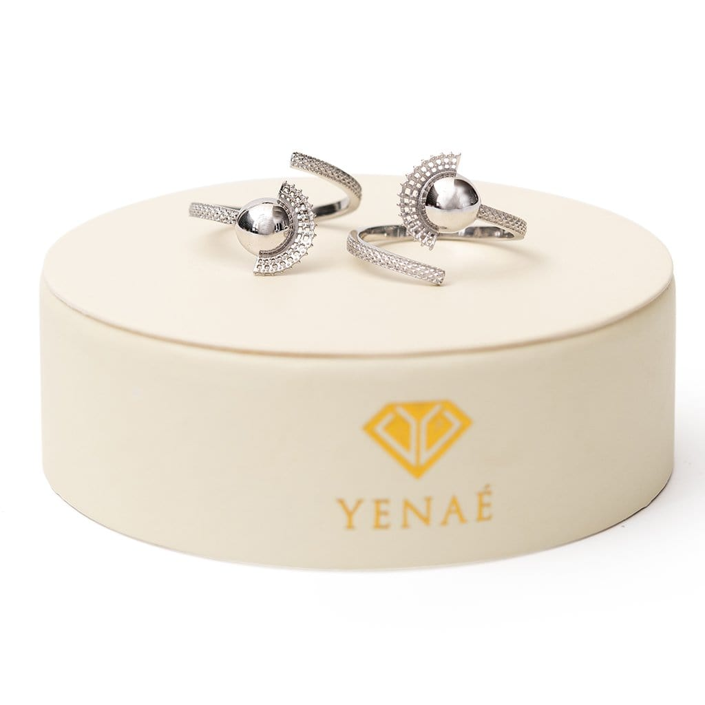 Yenaé Rhodium plated Tsirur Ring displayed on package.