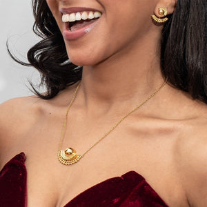Yenae 14K Gold plated on brass Tsirur Necklace worn by a model.