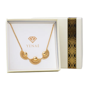 Yenaé 14K real gold Tsirur Statement Necklace displayed in a box.