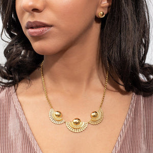 Yenae 14K Gold plated on brass Tsirur Statement Necklace worn by a model.