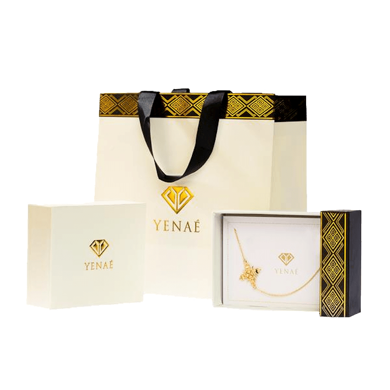 Yenaé Gift Ready Packaging Displayed with a Packaged Cross Necklace