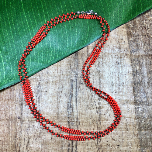 Coral with dark brown thread