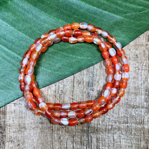 Tiny Orange Oval Beads - 100 Pieces