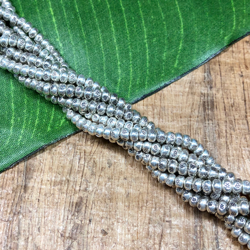 3mm/4mm flower stamped hill tribe strands