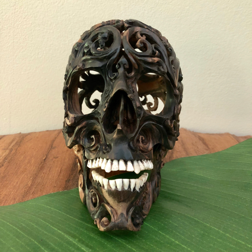 carved wood skull