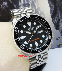 Seiko SKX007K2 black dial, stainless steel and mineral glass material