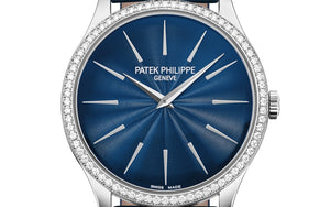 Patek Philippe 4897G-001 features blue dial, Guilloche finish, stick dot indexes and Dauphine hands