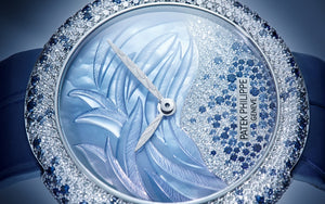 Patek Philippe 4899/901G-001 features blue dial, mother of Pearl material, none indexes, Alpha hands